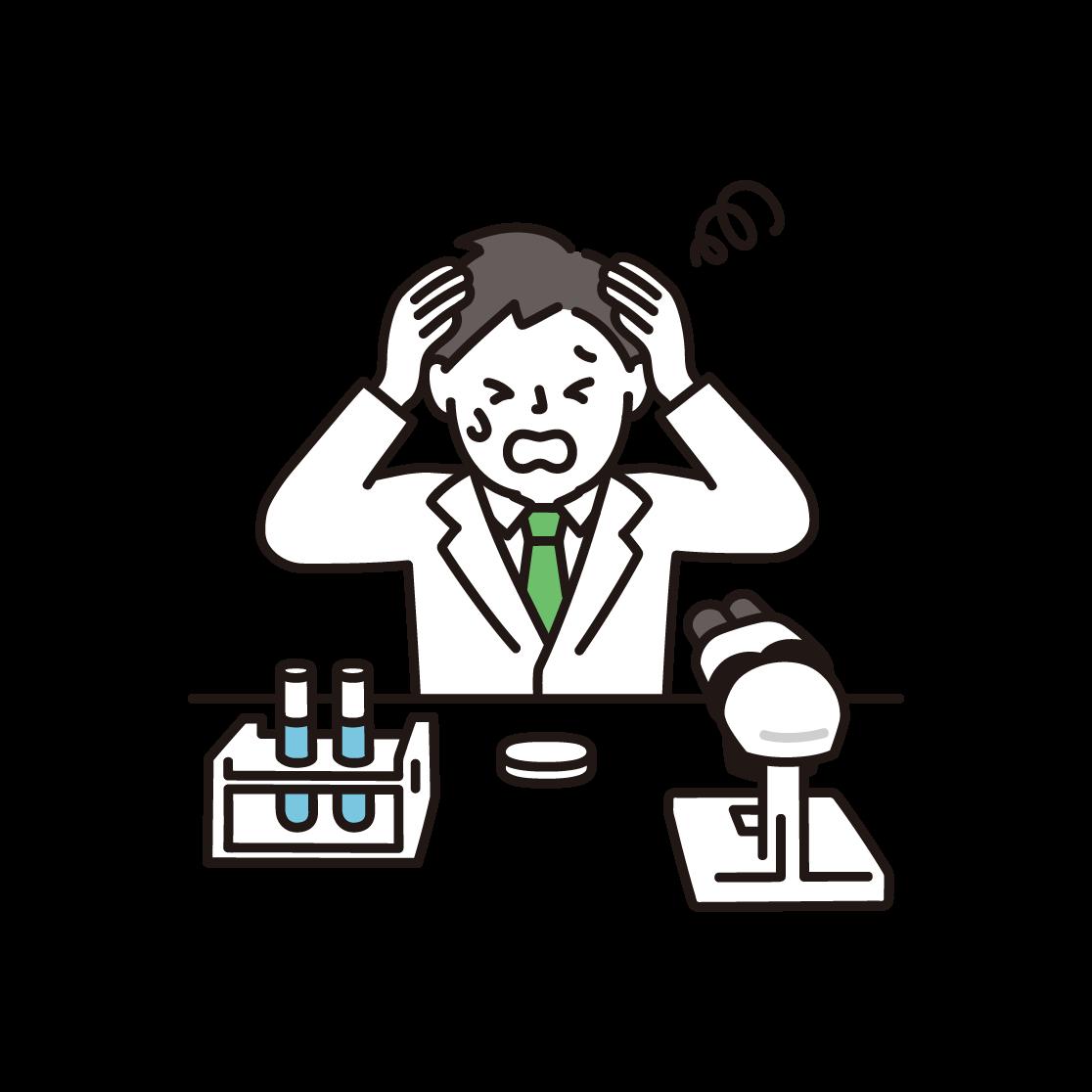 頭を抱える研究者(男性)