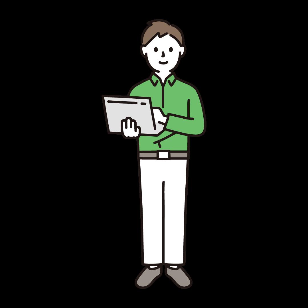 パソコンを持って立っている男性