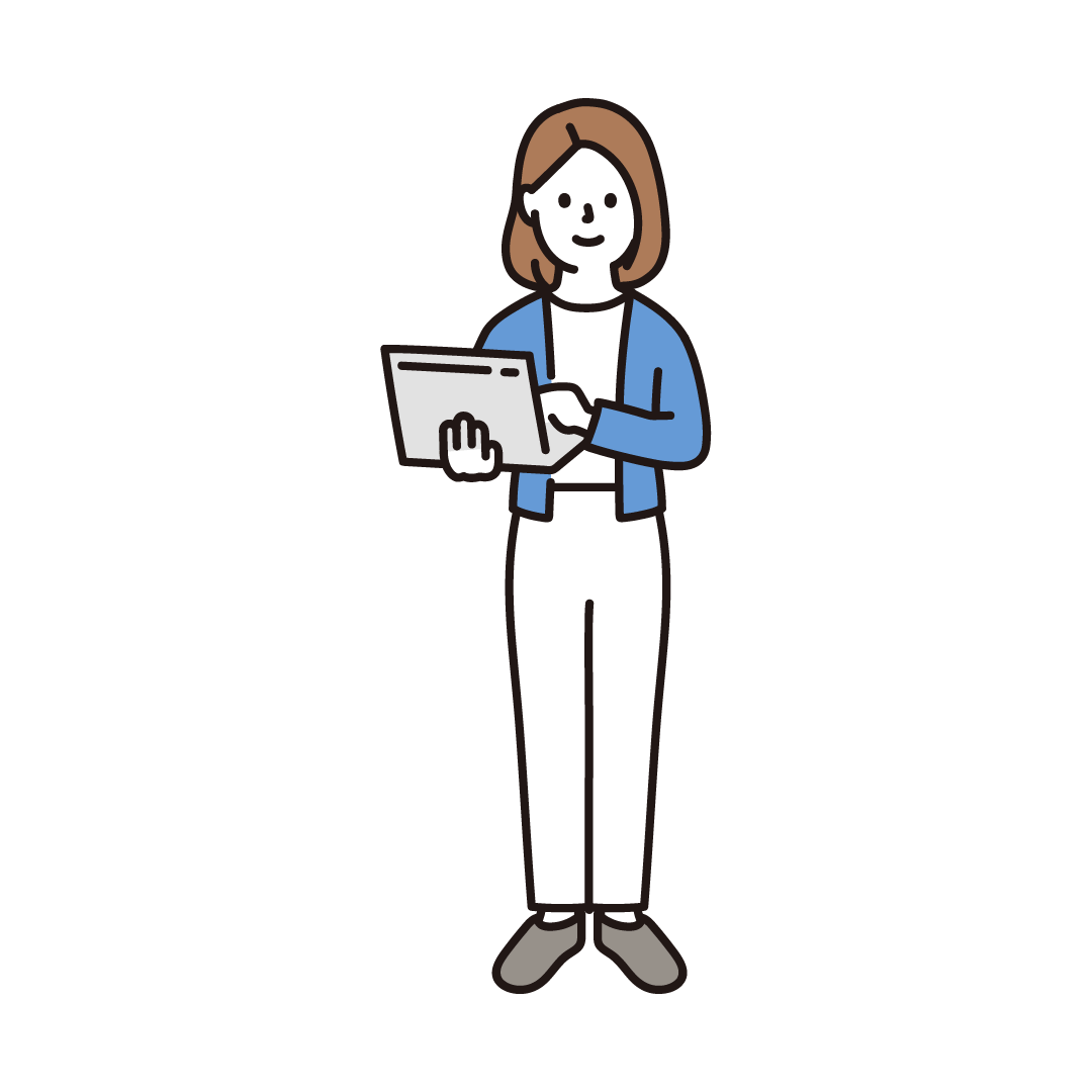パソコンを持って立っている女性