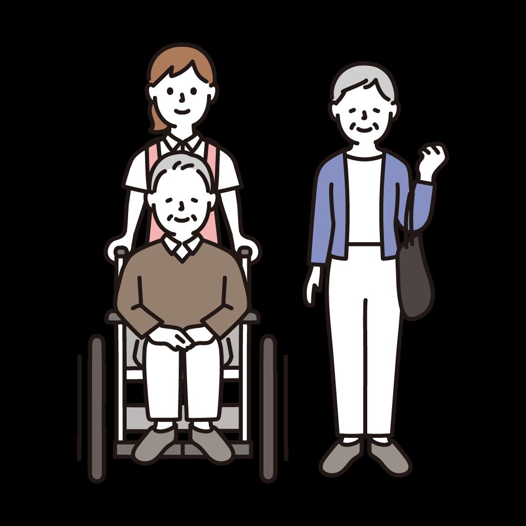 車いすの高齢者夫婦と女性介護士