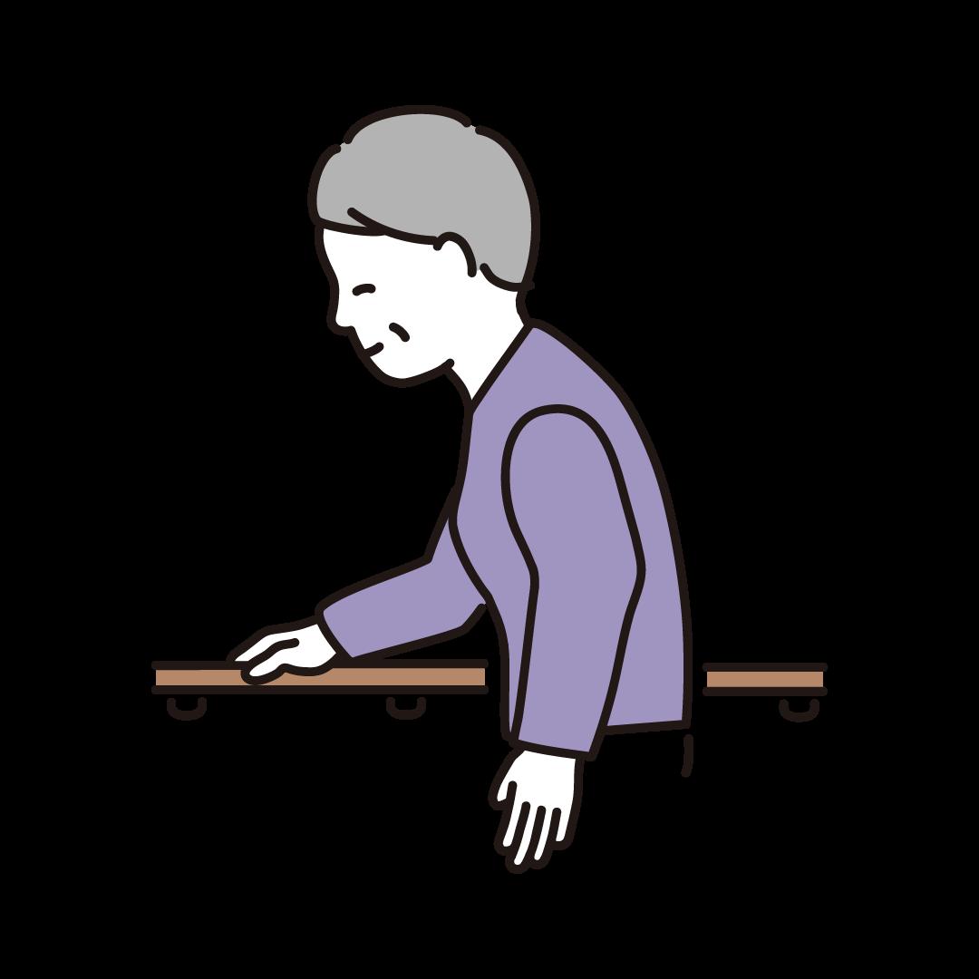 手すりに捕まって歩く高齢者(女性)